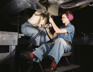 Female Engineers Working On Plane